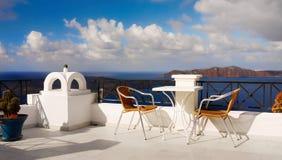 Street Cafe, Restaurant Terrace, Sea view. Cafe table and chairs on Restaurant terrace with sea view. Greece Santorini island Stock Image