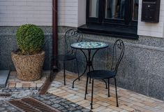 Street cafe table and chairs stock photography