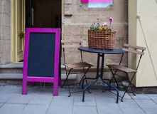 Street cafe table. Street cafe entrance table and advertising board Stock Images
