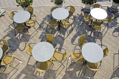 Street cafe tables and chairs on pavement Stock Photography