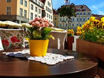 Free Street Cafe Tables  Chairs With Cup Of Coffee Flowers  City Lifestyle Summer Day In Old Town Of Tallinn  Travel And Tourism To Est Stock Images - 151977274