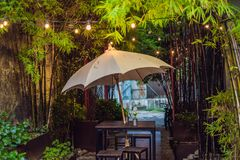 A street cafe with an umbrella and lights royalty free stock photography