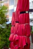 Street cafe umbrellas. On the promenade in  small city Saarburg, Rheinland-Pfalz, Germany Royalty Free Stock Photos