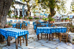 Street and cafe view at Makrinitsa village of Pelion, Greece. Typical greek tavern, restaurant or cafe view at Makrinitsa village of Pelion, Greece Stock Image