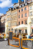 Street cafe on Warsaw`s Old Town Market Place Rynek Starego Miasta on sunny day, which is center and oldest part of Warsaw Stock Photo