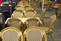 Street cafe with wicker chairs. Stock Images