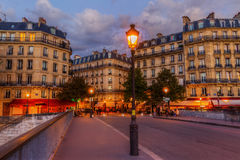Street cafes on the Ile Saint Louis in Paris at night Stock Images