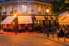 Street cafes on the Ile Saint Louis in Paris at night Royalty Free Stock Images