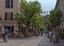 Street Cafes, Valldemossa, Majorca. Street cafes and bars lining the attractive Via Blanquerna in Valldemossa, one of the prettiest villages in Mallorca Royalty Free Stock Image