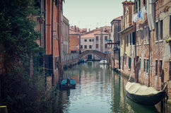 The street canal lit with old houses and boats, Venice, Italy. City landscape of Venice. The street canal with old houses, boats Royalty Free Stock Images