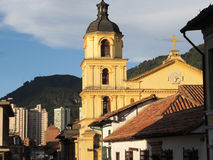 Street of the Candelaria in Bogota, Colombia. Street of the Candelaria neigborhood with mountains and buildings in the background, in Bogota, Colombia Stock Photography