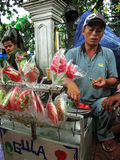 Street Candy Vendor. An Indonesian makes candies at Malioboro Street in Yogyakarta, Indonesia. Malioboro street is one of the most famous street for tourists who Stock Photo