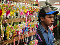 Street Candy Vendor. An Indonesian sell candies at Malioboro Street in Yogyakarta, Indonesia. Malioboro street is one of the most famous street for tourists who Royalty Free Stock Photos