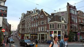 Street canyon in Amsterdam leading to Leidse Square City of Amsterdam stock video footage