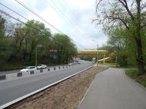 Street, car, pedestrian bridge. Royalty Free Stock Photography
