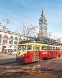 Street car or trollley or muni tram in front of San Francisco Ferry Building in Embarcadero - San Francisco, California, USA royalty free stock photography