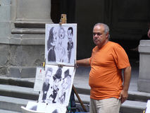 Street caricature painter in Florence. Are located around center of the city where are numerous tourists attractions Stock Photos