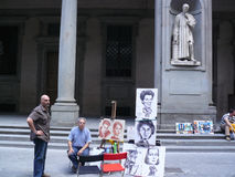 Street caricature painter in Florence. Are located around center of the city where are numerous tourists attractions Royalty Free Stock Photography