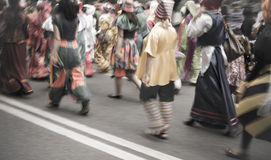 Street carnival parade. Special lens blur Royalty Free Stock Photography