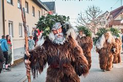 Group of haired poachers. Street Carnival in Southern Germany - Black Forest royalty free stock photos