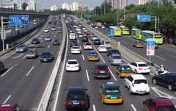 Street with cars in Beijing. Street with lots of cars in Beijing of China. On Aug.13,2012 Royalty Free Stock Photos