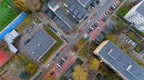 Street with cars top aerial city view from drone royalty free stock photography