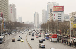 Street with cars in Wuhan of China. Street with lots of cars in Wuhan of China.Wuhan   (simplified Chinese: 武汉)  is the capital of Hubei province, People's Stock Photography