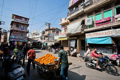 Street cart with tangerines driven by fruit vendors Stock Image