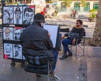 Street cartoonist with model Stock Image