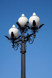 Street cast iron antique lamp with three white plafonds Stock Image