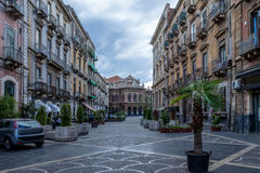 Street of Catania with the famous Opera Theatre Teatro Bellini on background - Catania, Sicily, Italy stock photography