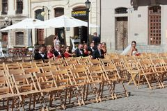 Street celebration of the wedding. That`s how the family wedding on the street in our city of Lviv is celebrating the Catholic swedge. All passers-by can stock image