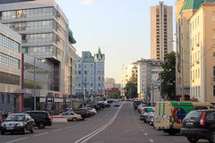 A Moscow street in summer with many buildings and parked cars. A street in the Central district of Moscow in summer with many buildings and parked cars, empty Royalty Free Stock Photography