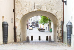 The medieval arch and street in old Riga, Latvia. Stock Image