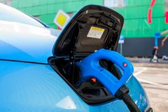 Street charging of electric cars. In the parking lot royalty free stock photo