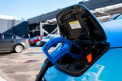Street charging of electric cars. In the parking lot royalty free stock photos
