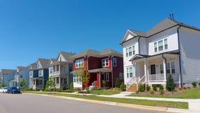 Street of suburban homes. Street of charlestone style suburban homes royalty free stock photos