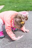 Street charlk art. Toddler drawing with chalk on paved walk near playground Royalty Free Stock Photos