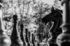 Street chess pieces in monochrome. background. close up stock photography