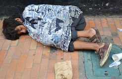Street Child in Colombia. A street child sleeping in Colombia stock image