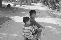 Street children. PHNOM PHEN, CAMBODIA MARCH 23: Unidentified street children posing on march 23 2013 in Phnom Phen,Cambodia.In Phnom Penh alone there are between stock photos