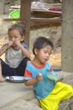 Street children. PHNOM PHEN, CAMBODIA MARCH 23: Unidentified street children posing on march 23 2013 in Phnom Phen,Cambodia.In Phnom Penh alone there are between stock image