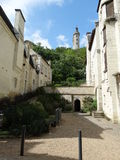 Street and Chinon castle in background. Medieval street in Chinon with castle in the background Stock Photo