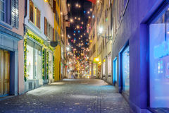 Street at Christmas, Zurich. Night street scene in the Old Town (Altstadt), with Christmas decoration lamps in multiple colors, in Zurich, Switzerland Stock Photos