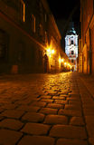 Street with church by night in Poznan Royalty Free Stock Image