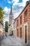 Street and the Church of Our Lady in Bruges, royalty free stock photo