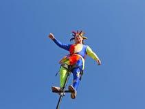 Street circus clown on a mast Stock Photos