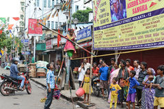 Street Circus. Little poor girl walking on a slack rope in an small street circus performance at Kolkata.It's a one kind of earning process Royalty Free Stock Photos