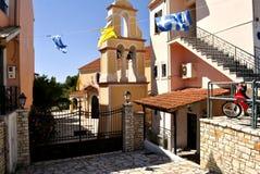 Street of the city of Aharavi, Corfu, Greece. Church of the city of Aharavi in Greece. Island Corfu Stock Photos