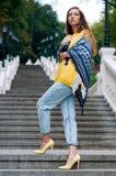 Street city fashion redheaded girl with long hair stock photo